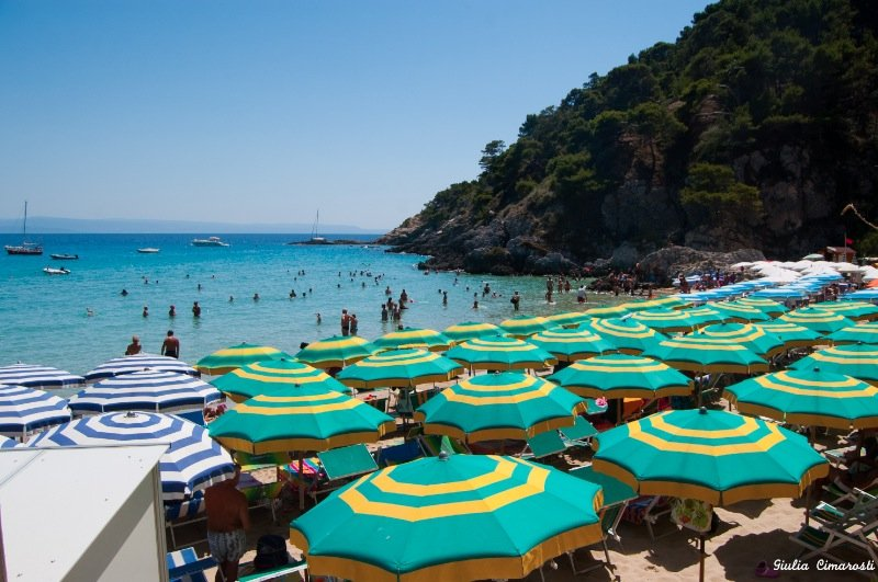 The crowded still beautiful sand beach in San Domino Island, Tremiti
