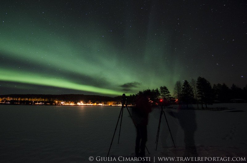 Photographing the northern lights while on a frozen lake
