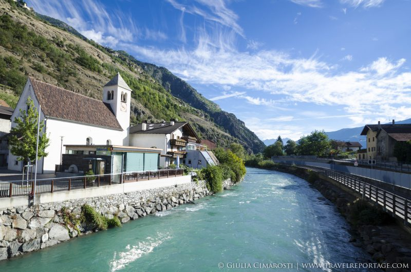 Typical Winschgau Valley scenery: the Adige river and its blue water and towns on its banks