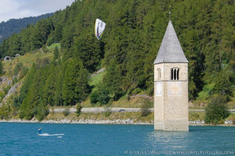 Kitesurfing by the steeple in Resia Lake, Reschensee