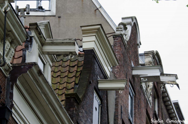 Amsterdam hooks on buildings