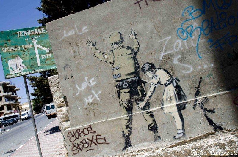 Banksy's girl frisking soldier