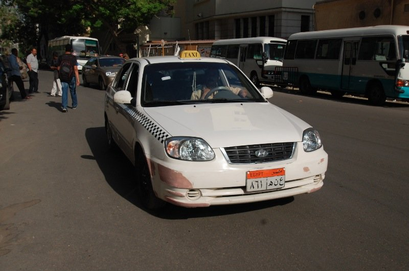 The white taxis in Cairo are the ones with meters.