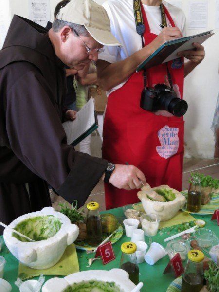 The monk trying the Pesto and judging
