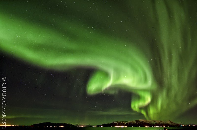 Green - the Northern Lights over Reykjavik, Iceland
