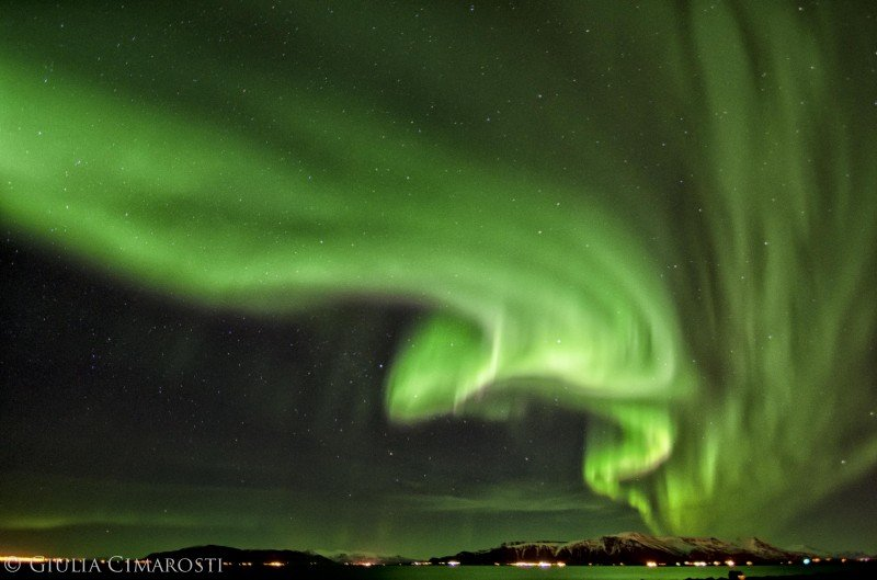 Strong Northern Lights above Reykjavik, Iceland